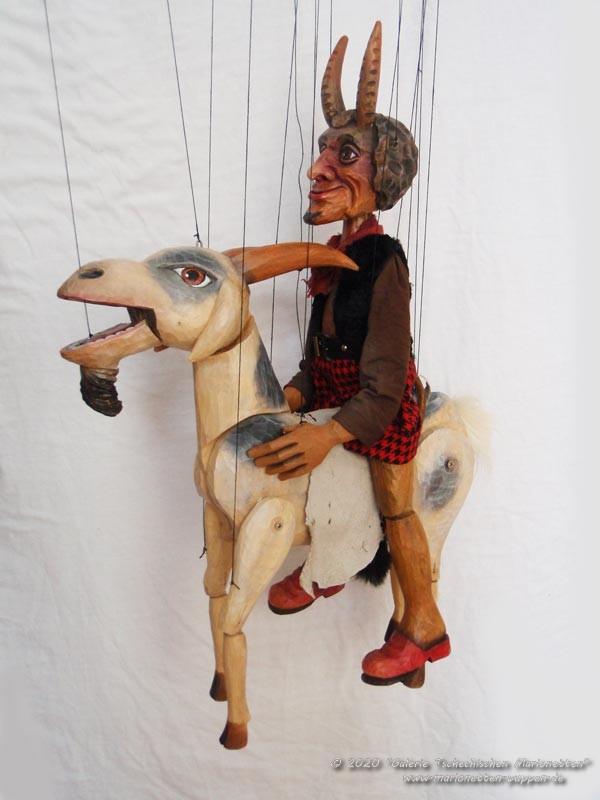 Diable sur une chèvre marionnettes